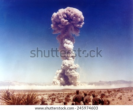 The DOG shot. Military personnel observing a 21 kiloton atomic test. 6,500 soldiers participated in exercises coordinated with the nuclear tests of the Buster-Jangle series. Nov. 1, 1951. - stock photo