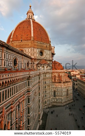 The dome of the Florence Duomo in late afternoon, with a view over town square. - stock photo