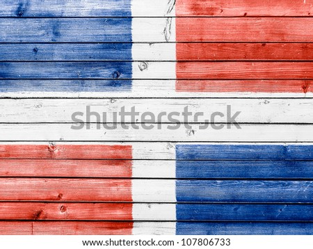 The Dominican Republic flag painted on wooden fence - stock photo