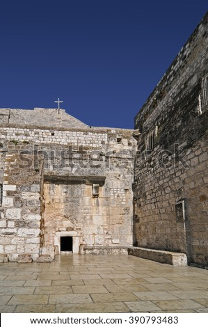 The Door of Humility, main entrance into the Church of the Nativity, Bethlehem, West Bank, Palestine, Israel - stock photo