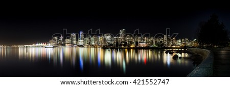 The downtown Vancouver skyline at night from Stanley Park. - stock photo