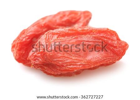 The dried fruit of medlar on white background - stock photo