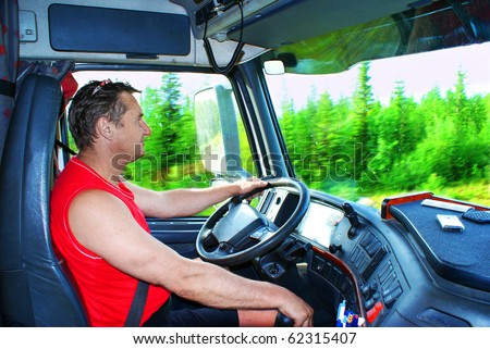 The driver working in the cabin of the truck - stock photo