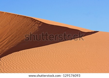 The dune and the sky - stock photo