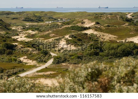 The dunes and North-Sea in the Netherlands - stock photo