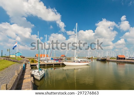 The Dutch harbor of Hindeloopen on a sunny summer day - stock photo