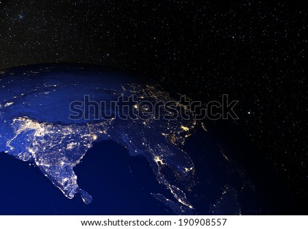 The Earth from space at night, with stars in the background. India. Elements of this image furnished by NASA. Other orientations available.  - stock photo