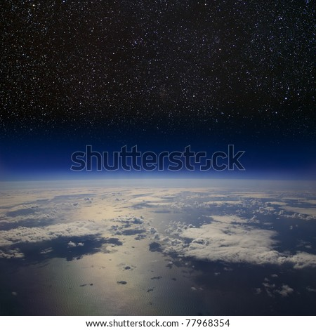 The Earth in space. High altitude view of the surface against the starry night sky. - stock photo