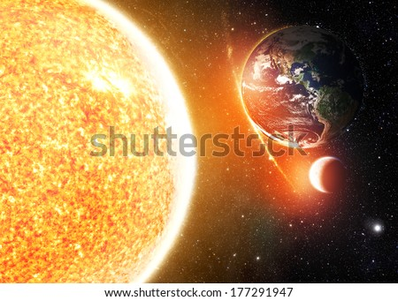 The Earth, Sun and Moon - Elements of this image furnished by NASA - stock photo