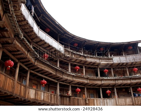 The Earth Tower of Hakka  -an ancient Chinese building in Hujian, China which was in the world heritage by UNESCO. It was taken in spring festival, lots of lanterns decorating  the building - stock photo