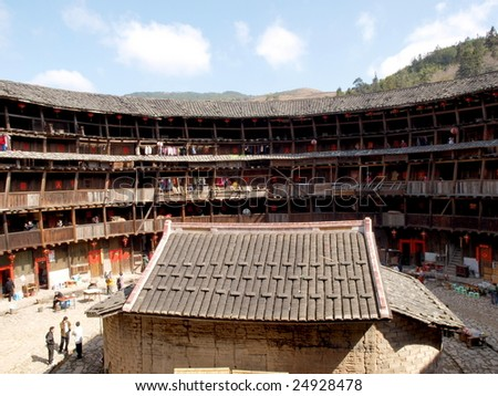 The Earth Tower of Hakka .An ancient Chinese building  which list in the world heritage . It contains hundreds of  apartmenst, each  is for one family. The house iIn  cental is their ancestral hall. - stock photo