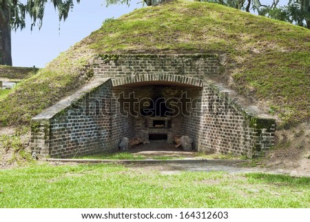 The earthen fortified Hot Shot Furnace used to super heat cannon shot for anti-ship bombardment during the Civil War at Fort McAllister, Georgia. - stock photo