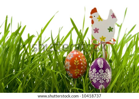 the easter eggs and hen in grass - stock photo