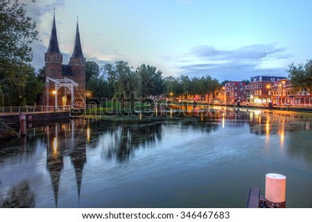 The Eastern Gate (Oostpoort) in Delft at evening time - The Netherlands. - stock photo