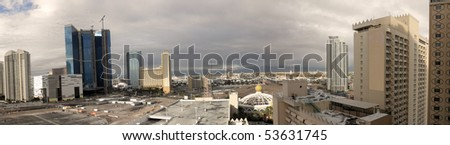 The eastern part of Las Vegas Strip from viewed a high up hotel room on a cloudy morning featuring Sahara street intersecting Las Vegas Boulevard. - stock photo