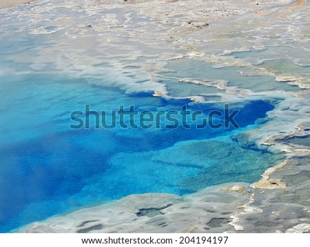 the  edge of artemisia geyser in the cascade  geyser basin in yellowstone national park, wyoming         - stock photo