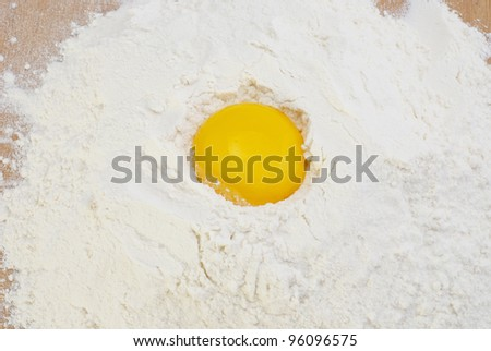 The egg in the flour - stock photo