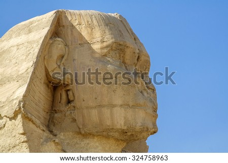 The Egyptian Sphinx, head of the Sphinx, Egyptian pyramids and historical places. The ruins of antiquity, travel and tourism. The archaeological excavations. The ancient civilization of the pharaohs. - stock photo