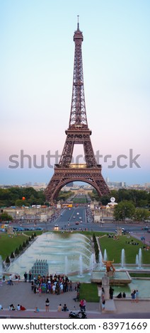 The Eiffel Tower and Champ de Mars in the evening at sunset - stock photo