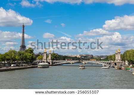 The Eiffel Tower and Pont Alexandre III at night in Paris, France - stock photo