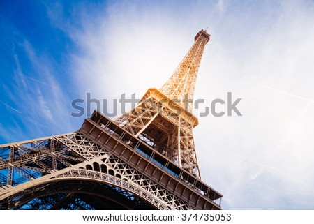 The Eiffel Tower at sunset in summer. Sun effect added - stock photo