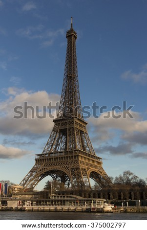 The Eiffel tower is a wrought lattice tower on the Champs de Mars in Paris. The tower is the tallest structure in Paris and the most visited monument in the world. - stock photo