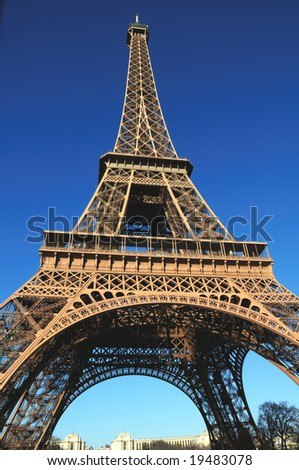 The Eiffel Tower is an iron tower built on the Champ de Mars beside the River Seine in Paris. The tower has become a global icon of France and is one of the most recognizable structures in the world. - stock photo