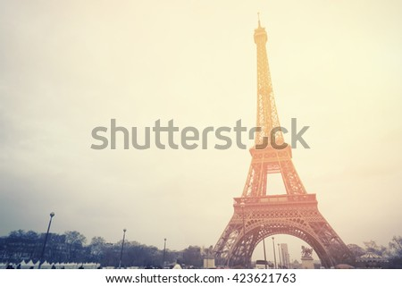The Eiffel tower is one of the most recognizable landmarks in the world under sun light,selective focus,vintage color - stock photo
