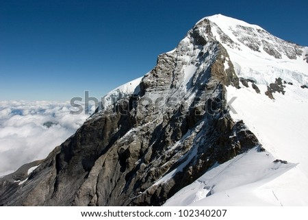 The Eiger (3,970 m (13,025 ft) - a mountain in the Bernese Alps in Switzerland - stock photo