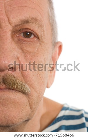 The elderly man close up. Half of face - stock photo