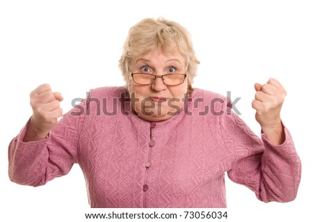 The elderly woman shows a fist - stock photo