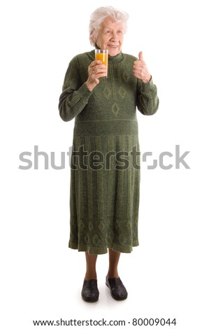 The elderly woman with a juice glass - stock photo