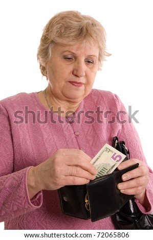 The elderly woman with a purse - stock photo