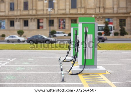 The electric charging station for electric vehicles. An electric car charging.   - stock photo