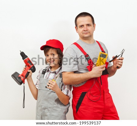 The electric team - father and son ready for some electrical work - stock photo