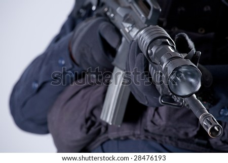 The electric torch is attached to a trunk of the army automatic machine-gun - stock photo