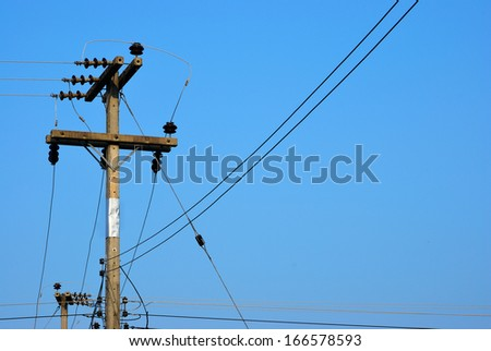 The electricity pole with many of line on the clear sky - stock photo