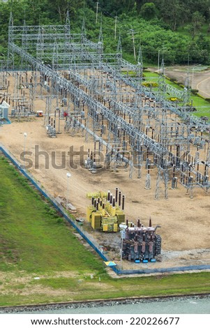 the electricity poles in hydroelectric station of dam - stock photo