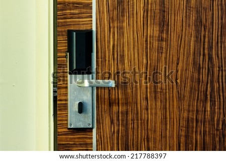 The electronic lock on a wooden door - stock photo