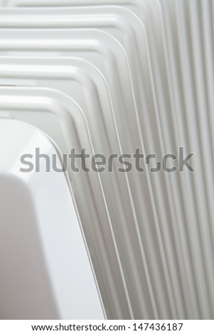 The elements of a white radiator photographed from the top and up close. - stock photo