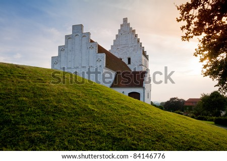 The Elmelunde church on the island Moen, Denmark, famous for its medieval frescos. - stock photo