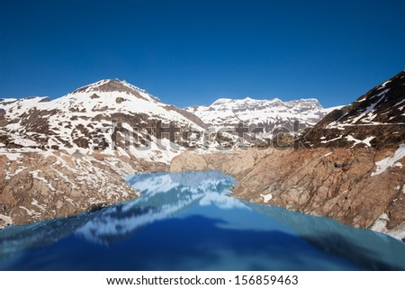 The Emosson dam hydroelectric near village of Chatelard, Swiss on the border with France - stock photo