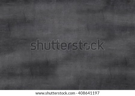 The empty black chalkboard/blackboard with traces removing or erase, background texture - stock photo