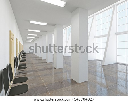 The empty long corridor with large windows - stock photo