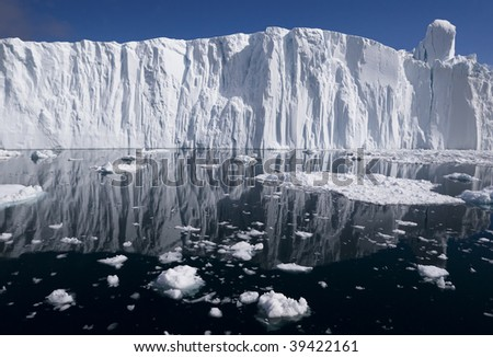 The end of a glacier, where the ice breaks up and falls into the freezing cold water - stock photo