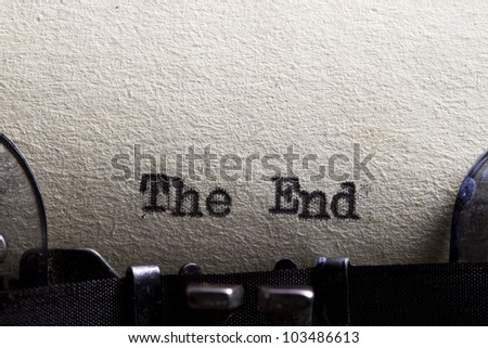 The end... written on an old typewriter and old paper. - stock photo