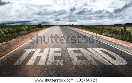The End written on rural road - stock photo