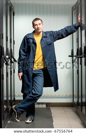 The engineer in coat stand in datacenter - stock photo