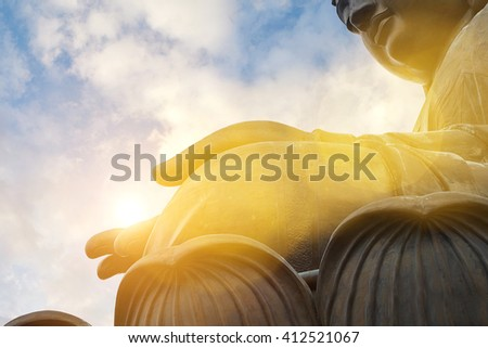 The enormous Tian Tan Buddha at Po Lin Monastery in Hong Kong. with color filter - stock photo