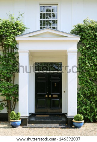 The entrance to an elegant Georgian country house - stock photo